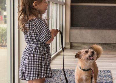 girl walking dog on leash